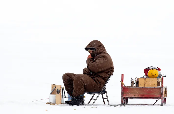 Claire Waring's photo capturing ice fishing on the frozen sea in Hokkaido, Japan places atop the People category.