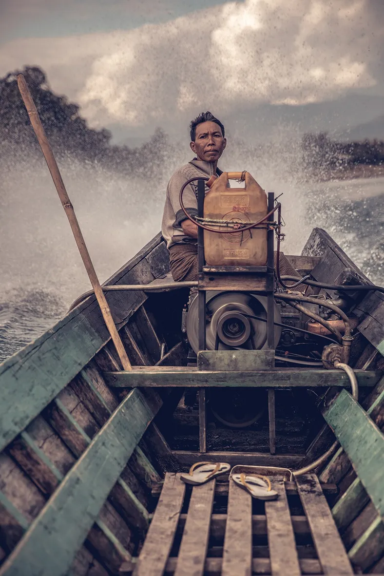 Rajiv Joshi's photo depicting a local boatman in Northern Myanmar also wins a runner-up award at the contest's People category
