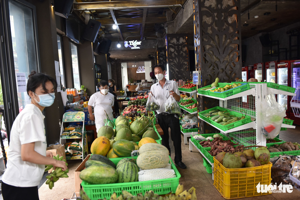 People shop for fruit at a vegetable store that was transformed from a bar on Bui Vien Street in District 1, Ho Chi Minh City. Photo: Ngoc Phuong / Tuoi Tre