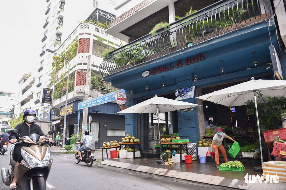 Bars, discos on Ho Chi Minh City's famous 'backpacker street' sell veggies to make ends meet