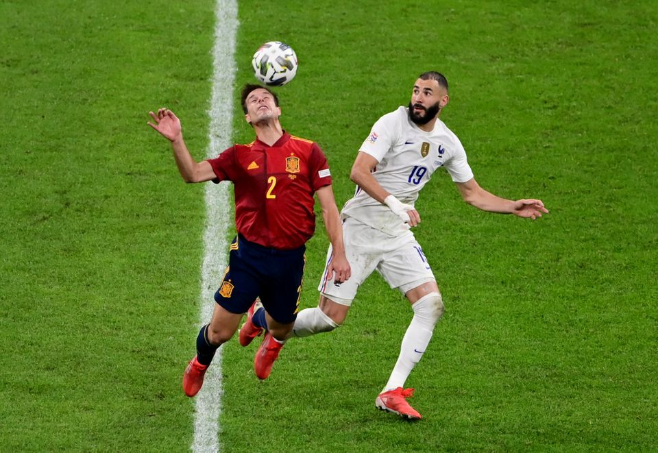 Soccer Football - Nations League - Final - Spain v France - San Siro, Milan, Italy - October 10, 2021 Spain's Cesar Azpilicueta in action with France's Karim Benzema. Pool via Reuters