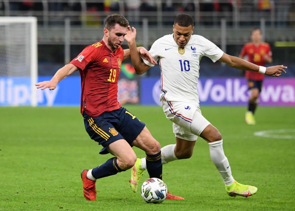 Soccer Football - Nations League - Final - Spain v France - San Siro, Milan, Italy - October 10, 2021 Spain's Aymeric Laporte in action with France's Kylian Mbappe. Photo: Reuters