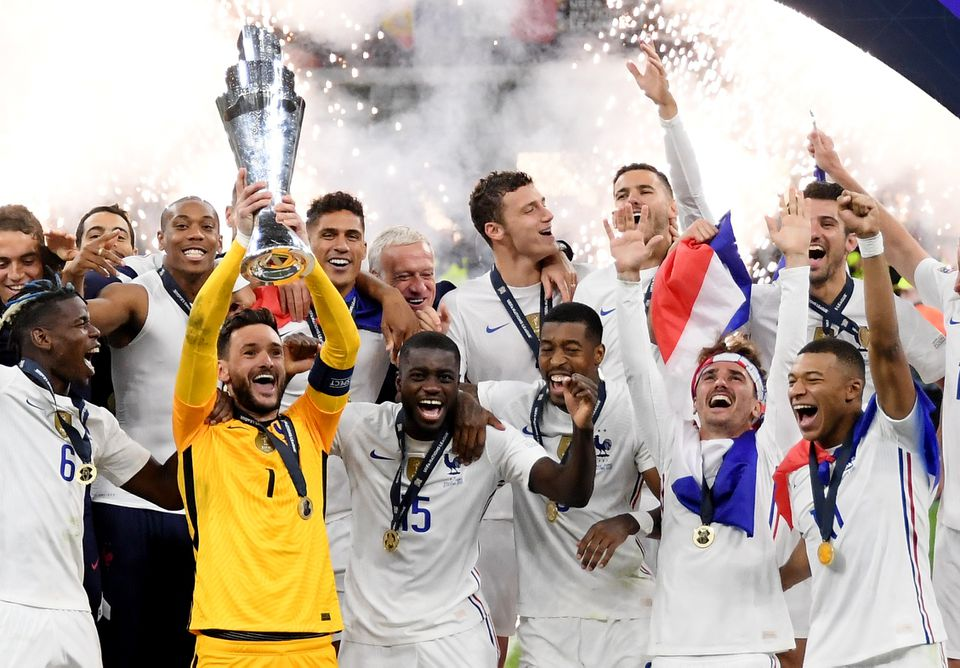 Soccer Football - Nations League - Final - Spain v France - San Siro, Milan, Italy - October 10, 2021 France's Hugo Lloris lifts the trophy as they celebrate after winning the Nations League. Photo: Reuters