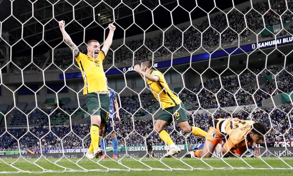 Soccer Football - World Cup - Asia Qualifiers - Group B - Japan v Australia - Saitama Stadium, Saitama, Japan - October 12, 2021 Australia's Mitch Duke celebrates their first goal, scored by Ajdin Hrustic. Photo: Reuters