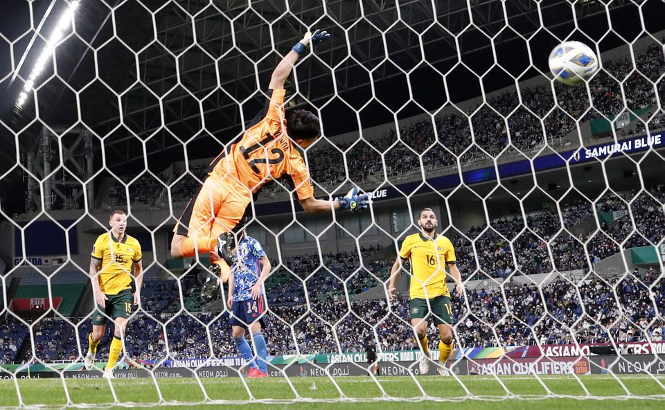 Late own goal ends Australia's record run and hands Japan much-needed win
