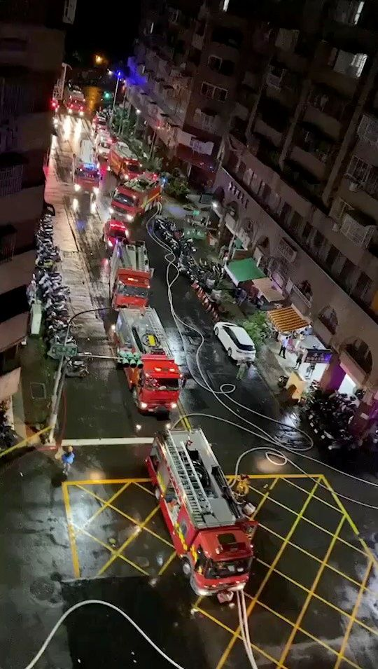 Fire trucks at the scene of a fire at Cheng Chung Cheng building in Kaohsiung, Taiwan in this still frame obtained from social media video dated early October 14, 2021. Photo: CHANG YU CHEN /via Reuters